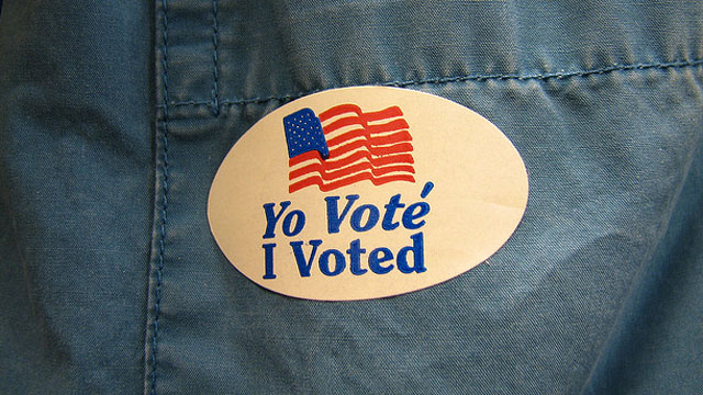 "PHOTO: An ""I voted"" sticker is displayed on a shirt pocket."