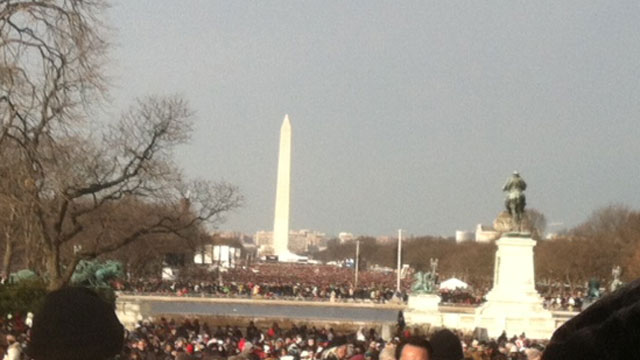 PHOTO: Crowds of people fill the Mall, all the way to the Washington Monument.