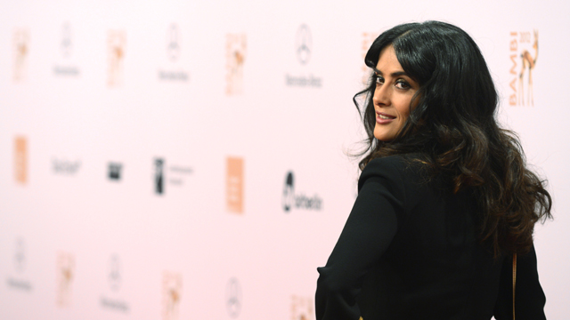 PHOTO: Mexican actress Salma Hayek poses for photographers as she arrives on the red carpet for the Bambi awards in Duesseldorf, western Germany, on November 22, 2012. The Bambis are the main German media awards.