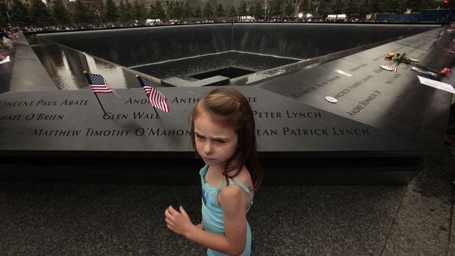 PHOTO: NEW YORK, NY - SEPTEMBER 11: Keri McMorrow, 7, visits the memorial pool where her uncles name is engraved.