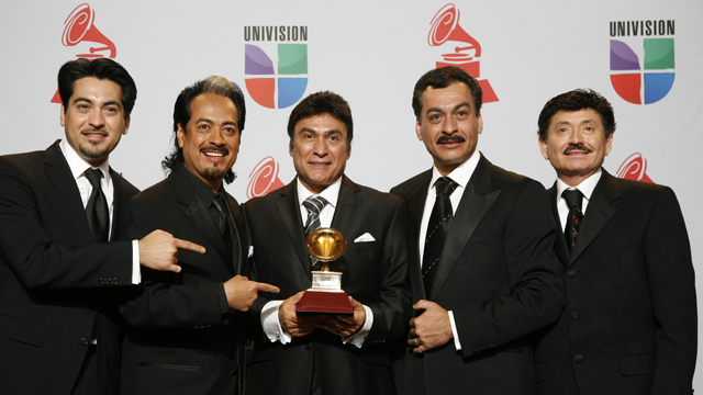 PHOTO: Los Tigres Del Norte pose with their award during the 12th annual Latin Grammy Awards at the Mandalay Bay Hotel and Casino Event Center in Las Vegas, Nevada on November 10, 2011.