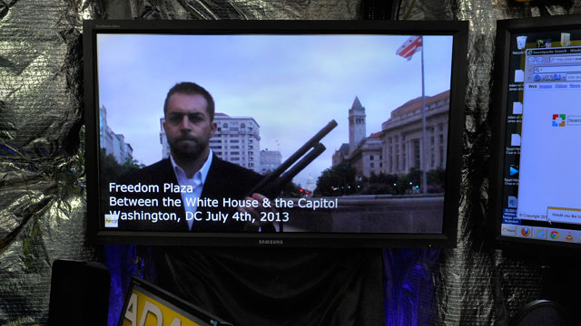 PHOTO: The Adam Vs. The Man political internet podcast plays on a monitor in the studio where Adam Kokesh produces a show.