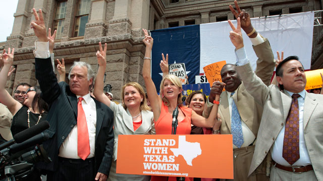 PHOTO: Texas Sen. Wendy Davis (D-Ft. Worth) is surrounded by supporting Texas representatives and senators after leading a rally in support of Texas womens right to reproductive decisions at the Texas state capitol on July 1, 2013 in Austin, Texas.