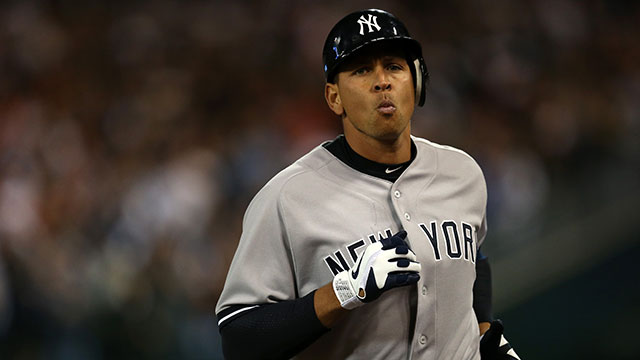 PHOTO: Alex Rodriguez #13 of the New York Yankees walks off the field back to the dugout after he grounded out in the top of the 9th inning against the Detroit Tigers during the American League Championship Series on October 18, 2012.