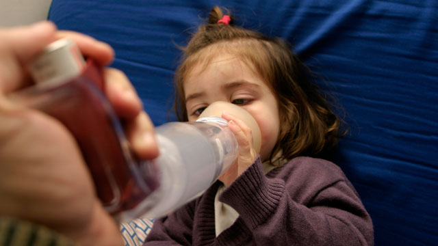 PHOTO: A young girl receives treatment for asthma. Health officials say ailments like asthma are linked to climate change.