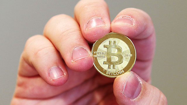 PHOTO: Bitcoin is an experimental digital currency used over the Internet that is gaining in popularity worldwide. Software engineer Mike Caldwell shows the front of a physical Bitcoin he minted in his shop on April 26, 2013 in Sandy, Utah.