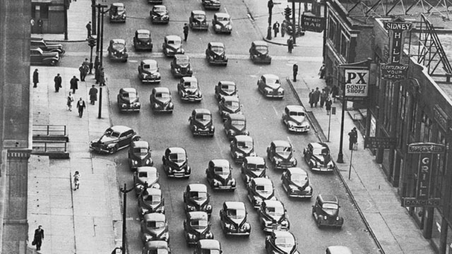 PHOTO: A line of cars, predominantly Ford cars carrying downtown commuters home from work in Detroit, Michigan, on the first day of the city-wide public transport strike.