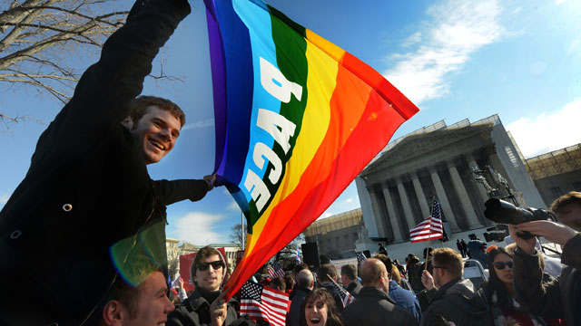 PHOTO: GW student Adam Sulier, center, rides on the shoulders of classmate Cam Tucker while waiting in front of the Supreme Court where arguments are being heard in a case against the Defense of Marriage Act on March, 27, 2013 in Washington, DC.