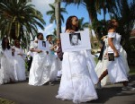 PHOTO:College students wear wedding gowns as they participate in the College Brides Walk from Barry University on February 8, 2013 in Miami Shores, Florida. The students walked six miles to raise awareness of the issue of domestic violence.