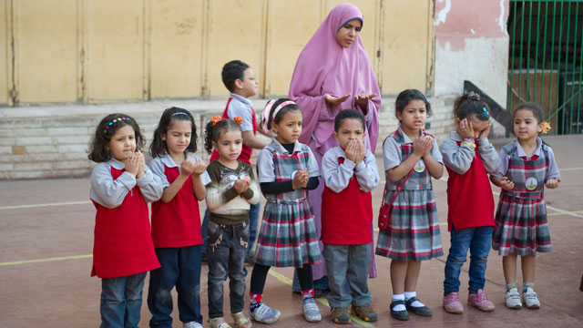 PHOTO: Primary school students recite morning prayers and salute the Egyptian flag during their morning routine in the playground at Al-Redwan Islamic School on November 8, 2012 in the Nasr City district of Cairo, Egypt.