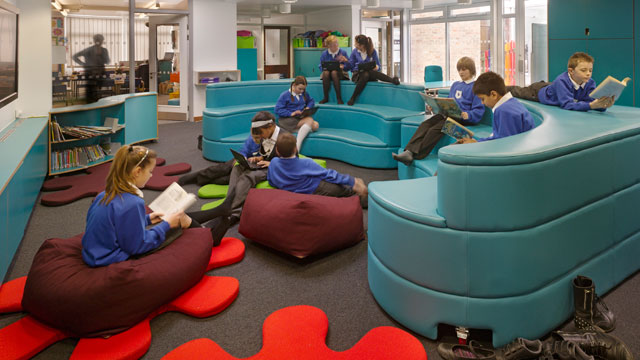 PHOTO: Children read at Towers Junior School on Windsor Road in London, Essex, United Kingdom.
