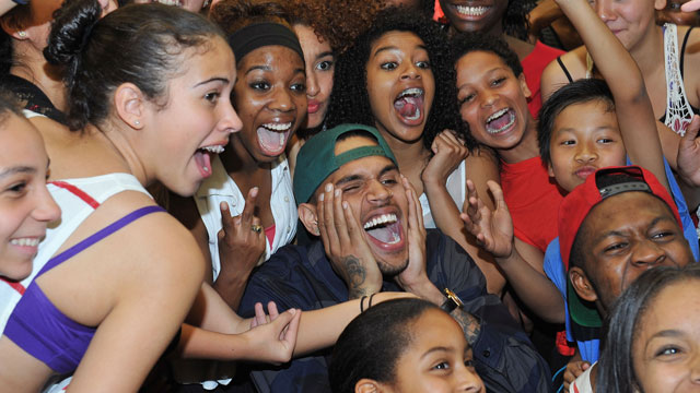 PHOTO: Chris Brown poses with excited fans during a visit to the Debbie Allen Dance Academy.