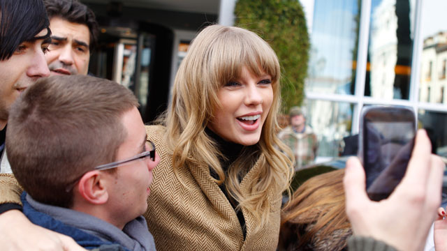 PHOTO: Taylor Swift smiles and poses with fans.