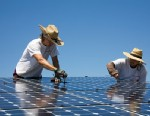 PHOTO:Green workers install a residential grid-tied solar array on a hillside in Malibu, California, USA.