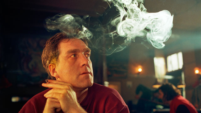PHOTO:A guy smokes a joint at an Amsterdam coffeeshop
