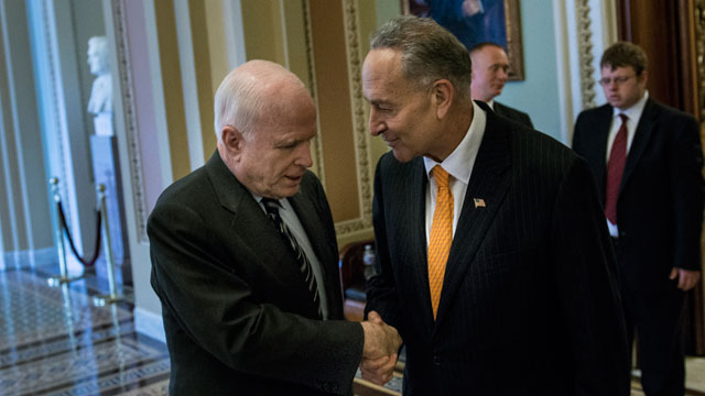 PHOTO: Senator John McCain (R-AZ) (L) and Senator Charles E. Schumer (D-NY), two authors of the immigration bill, shake hands after a test vote on Capitol Hill June 27, 2013 in Washington, D.C.