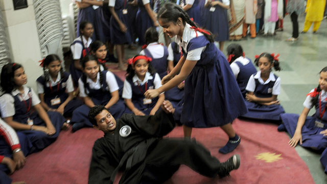 PHOTO: An Indian school girl (3R) practises self-defence with an instructor during a self-defence class at a school in Mumbai on January 4, 2013.