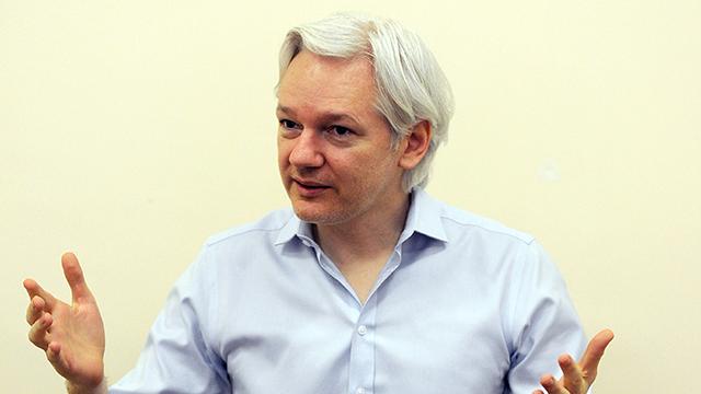 PHOTO:Wikileaks founder Julian Assange speaks to the media inside the Ecuadorian Embassy in London on June 14, 2013.