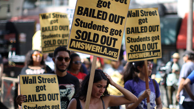 PHOTO:Students protest the rising costs of student loans for higher education on Hollywood Boulevard on September 22, 2012 in the Hollywood section of Los Angeles, California. Citing bank bailouts, the protesters called for student debt cancelations.