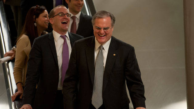 PHOTO: Sen. Mark Pryor (D-Ark.) jokes with his staff as they make their way from the U.S. Capitol to the Senate Subway on April 10, 2013.