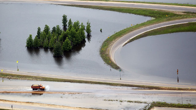 PHOTO: A truck drives along a flooded highway on the Mississippi River on May 23, 2011 in Vicksburg, Mississippi. Floodwaters are beginning to gradually recede in Vicksburg but are likely to remain above flood stage for weeks.