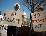 PHOTO:Tabu Henry Taylor (C) of Washington D.C., and Mike Crowe (R) of Springfield, Virginia, join a handful of protesters from anti-amnesty groups to demonstrate in front of the U.S. Capitol building on April 10, 2013.