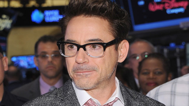 PHOTO: Robert Downey Jr. before ringing the opening bell at the NYSE on April 30, 2013 in NYC.