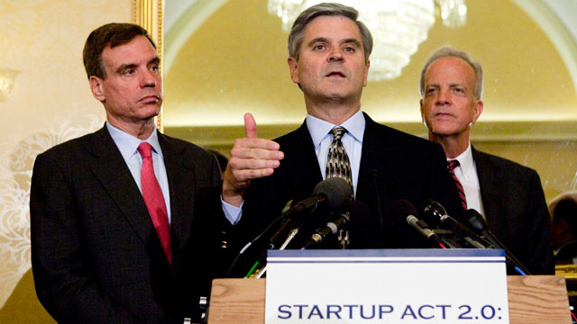 PHOTO: Steve Case, a member of President Obamas Council on Jobs and Competitiveness, speaks as Senators Jerry Moran (R-KS) and Mark Warner (D-VA) look on, at the Capitol in Washington, D.C., on Tuesday, May 22, 2012.