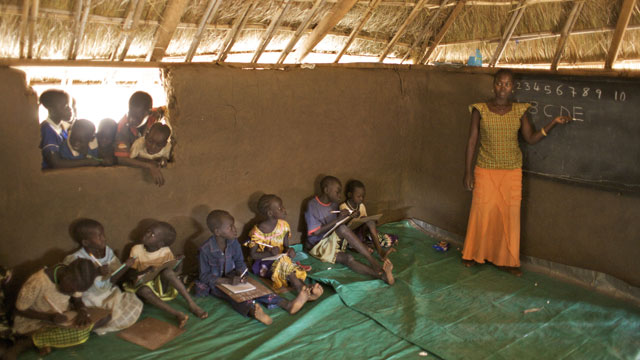 PHOTO: A teacher giving a class in a BRAC Non Formal Primary School, in the village of Hai Police, in Torid. Many children, who missed school due to decades of war and insecurity, are now attending BRAC schools in South Sudan.