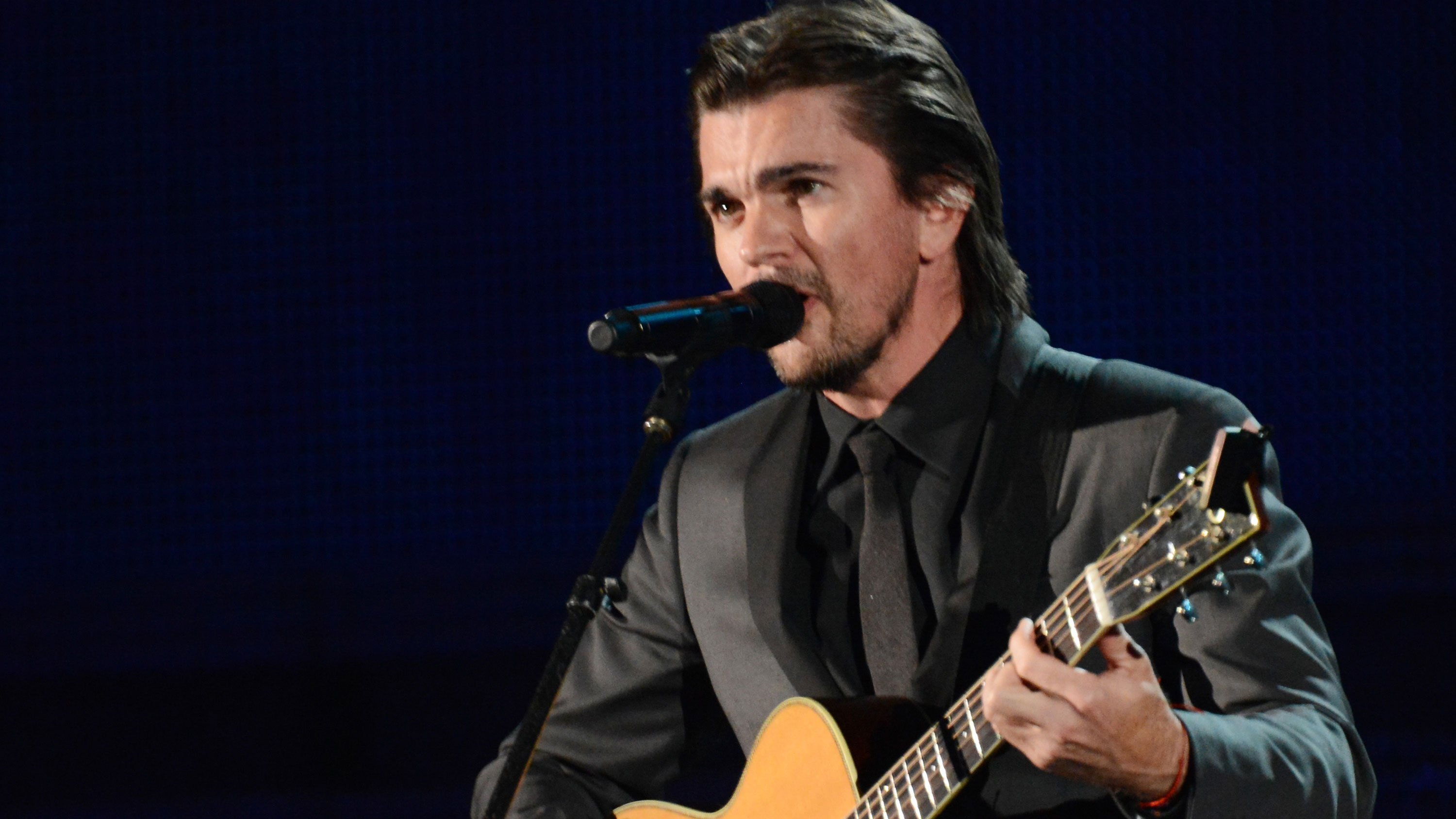 "PHOTO: Juanes continues the ""camisa negra"" theme."
