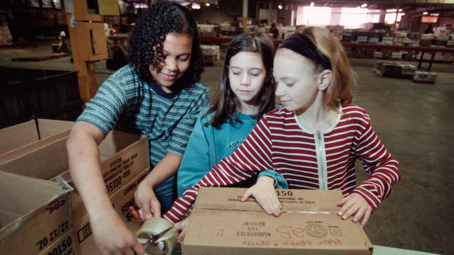 PHOTO: Volunteers package food at a food bank in New Jersey. Millions of children go hungry over the summer months, when some free meal programs wind down.