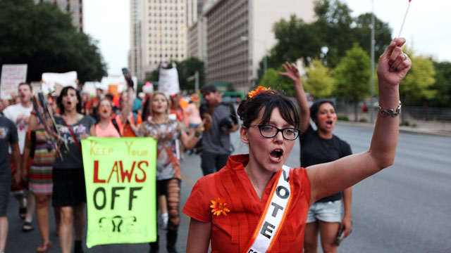 PHOTO: Pro-choice protesters march down Congress Avenue and back to the Texas state capitol as pro-life supporters and pro-choice protesters rally at the Texas state capitol on July 8, 2013 in Austin Texas.