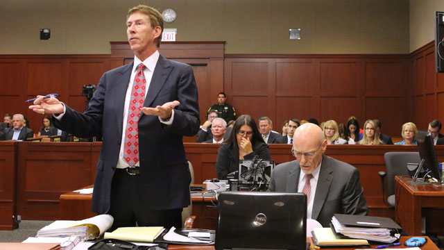 PHOTO:  Defense attorney Mark OMara argues a point, with co-counsel Don West and Lorna Truett during a pre-trial hearing