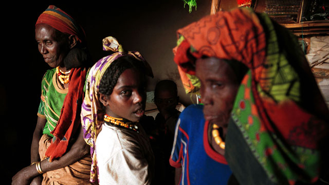 PHOTO: Two women and a girl stand in a shop February 9, 2001 in the Erer Valley, a rural area in eastern Ethiopia.