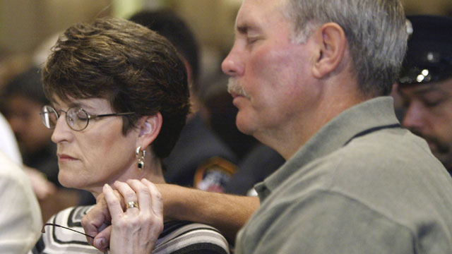 PHOTO:Richard Williams, Oklahoma City Murrah Federal Building bombing survivor, and his wife Lynne observe a moment of silence during the eighth anniversary memorial service at First Methodist Church April 19, 2003, in Oklahoma City, Olkahoma.