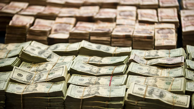 PHOTO:Parcial view of more than 1 Million Dollars seized to the alleged member of Zetas drug cartel Eric Jovan Lozano Diaz (out frame) aka Cucho, presented to the press in Mexico City, on June 15, 2012.