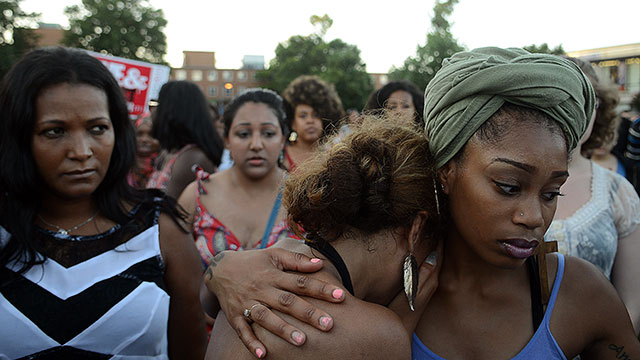 PHOTO: WASHINGTON, D.C., JULY 12, 2013: Felicia Brooks, second from left, is comforted by her friend, Niciah Petrovic, while attending a gathering sponsored by the Howard University NAACP chapter, for Trayvon Martin at Howard University.