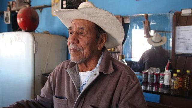 PHOTO:Candelario Valdez tends bar in Boquillas, Mexico.