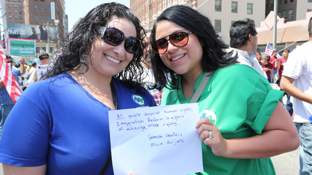 PHOTO: Vanessa Caballero (left) and Olivia Quijano demonstrate at a May Day rally in Los Angeles.