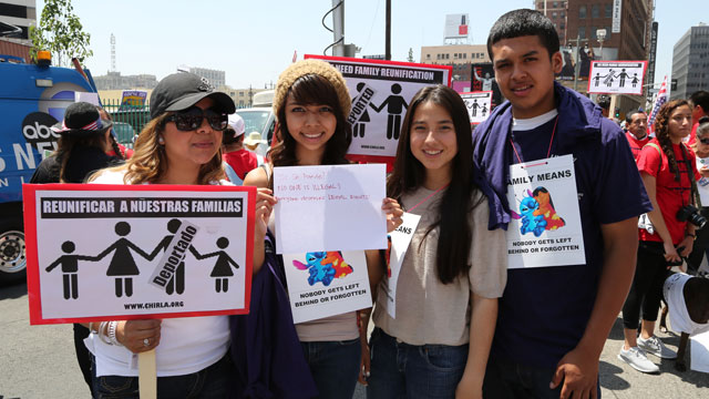 PHOTO: Beatriz Leon (left), Stephanie Mojica, Daniela Meza and Randolph Mojica demonstrate at a May Day rally in Los Angeles.