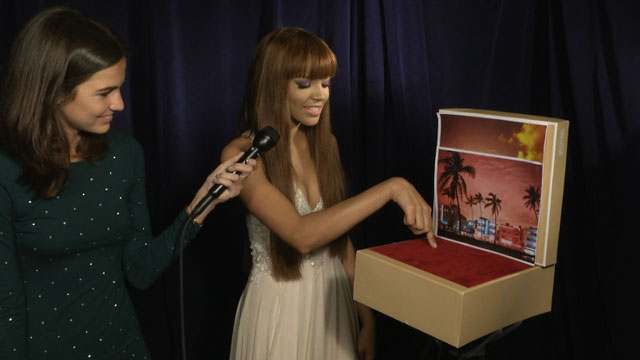 PHOTO: Singer Leslie Grace tries out our hand dancing set at the 25th annual Premio Lo Nuestro Latin music award show.