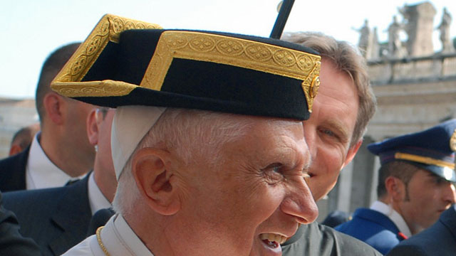 PHOTO: Pope Benedict XVI receives a hat of the spanish Guardia civil during his weekly audience in Saint Peter's Square at the Vatican, 25 Octobre 2006