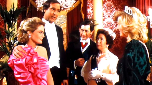 """PHOTO:Screenshot from a """"European Vacation"""" with Chevy Chase, with a spoof cameo by Queen Eliabeth II."""