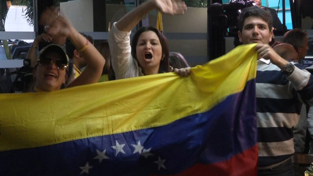 PHOTO: Venezuelans in Miami react to Chavezs death.