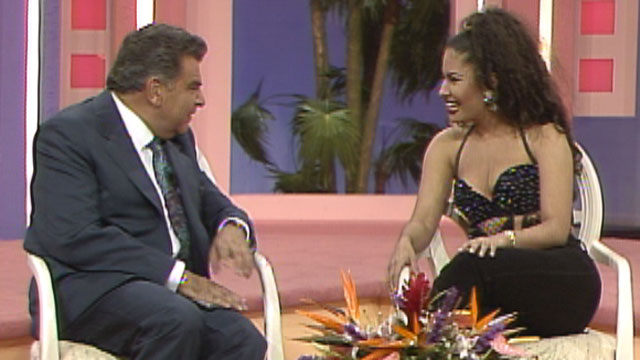 """Sabado Gigantes"" host Don Francisco sits with slain singer Selena during her appearance on the show in 1995."