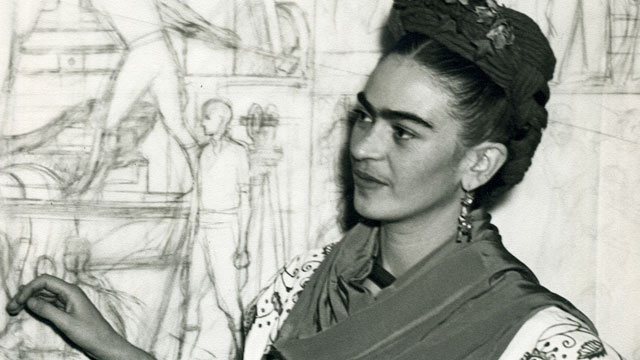 Frida Kahlo in front of a sketch of the Pan-American Unity murals central panel at the San Francisco City College Auditorium, 1940.