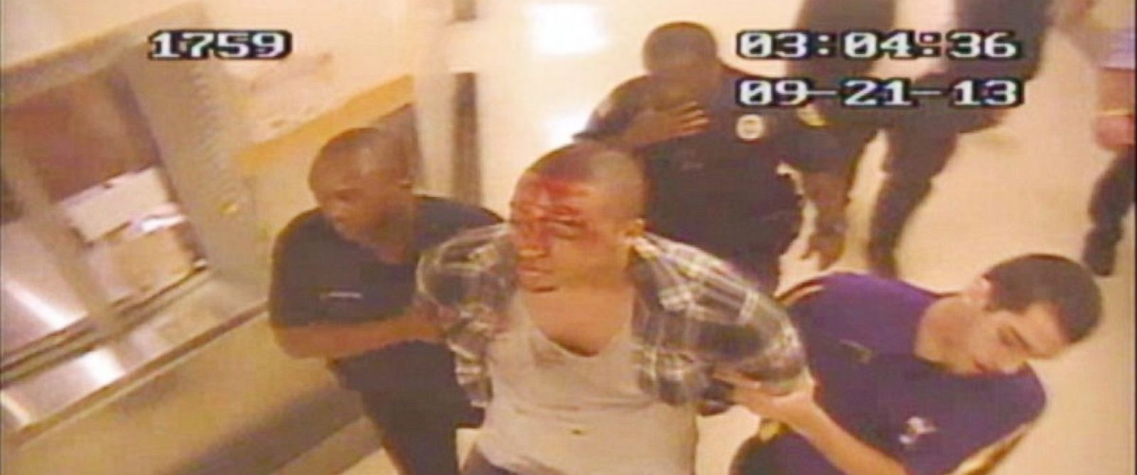 PHOTO: Rob Coney is brought to a back room in Harrahs Resort after an altercation with hotel security.