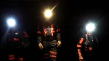 PHOTO: Coal miners illuminate their way with headlamps as they walk the long passageways of the Cumberland mine in Waynesburg, Pa., Sept. 9, 2010.