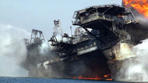 The Deepwater Horizon begins to list as it burns. The oil rig sank in the Gulf of Mexico on April 22, 2010.