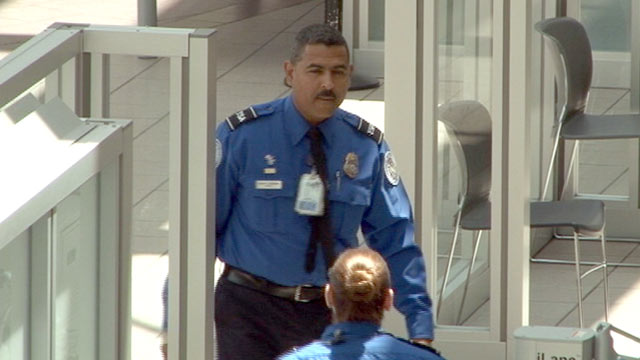 PHOTO: TSA agent Andy Ramirez is seen at a security checkpoint at Orlando International Airport on August 10, 2012.